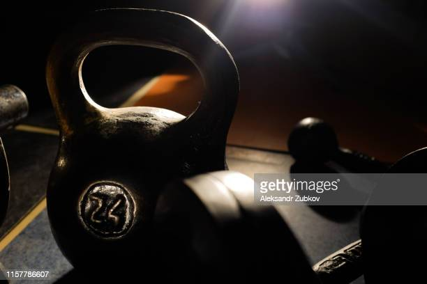 old and heavy kettlebell weight in dark room. - kilogram stock pictures, royalty-free photos & images