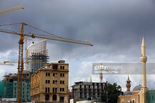 Old and new buildings mixed in the skyline of the Lebanese capital with the on site Marina Towers complex standing The development and rebuilding...