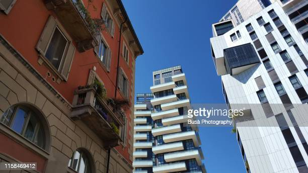 old and new residential buildings in the porta nuova district of milan, italy - milan stock pictures, royalty-free photos & images
