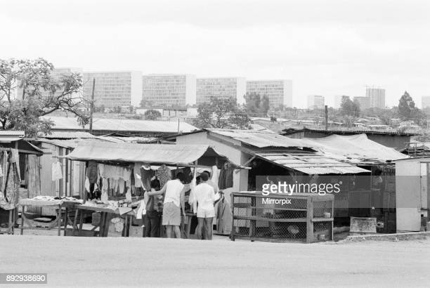 Old and New with Brasilia the planned city that became Brazil's capital in 1960 rising in the background locals look for a bargain in makeshift sheet...