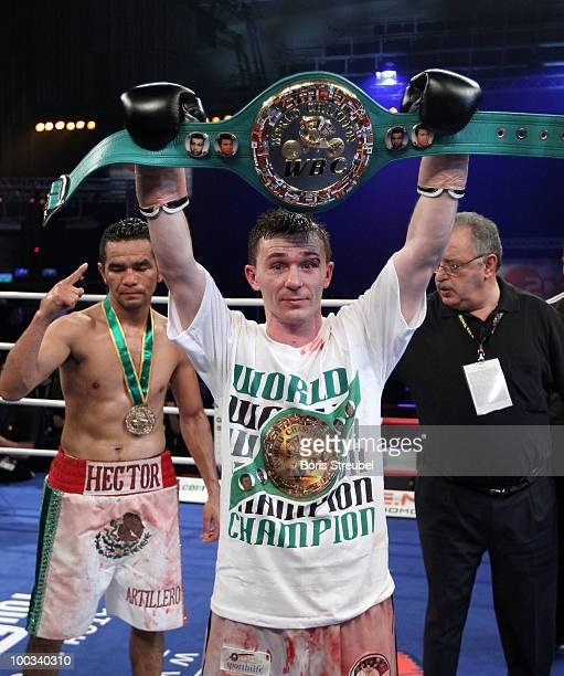 Old and new worldchampion Vitali Tajbert of Germany celebrates after winning the WBC super featherweight world championship title fight against...