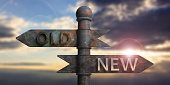 Old and new written on signposts isolated on sunset background. 3d illustration