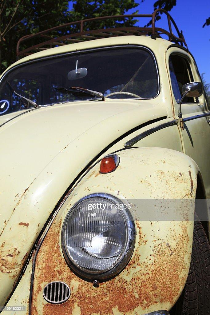Old and rusty beige Volkswagen (VW) Beetle : Stock Photo