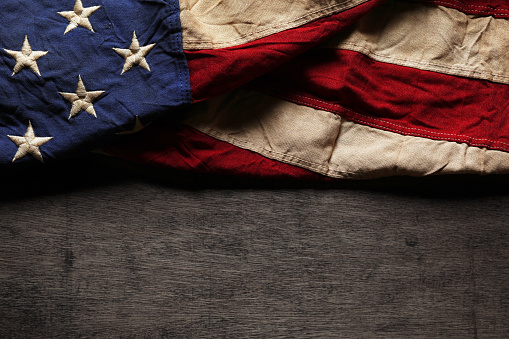 Old and worn American flag for Memorial Day or 4th of July 951416552
