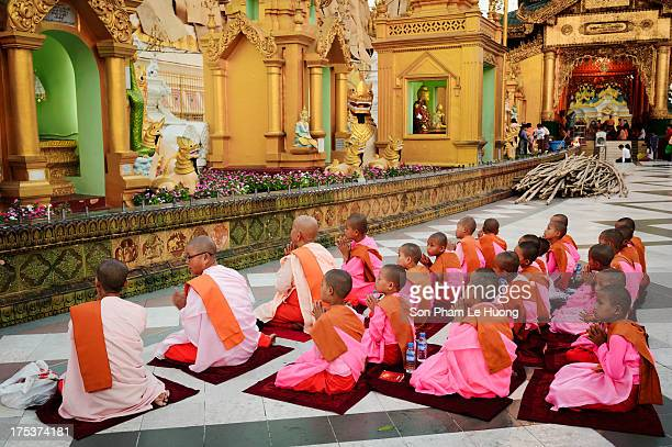 CONTENT] Old and young Buddhism nuns are praying before the pavilions of Shwedagon Pagoda Yangon Myanmar on Mar 05 2013