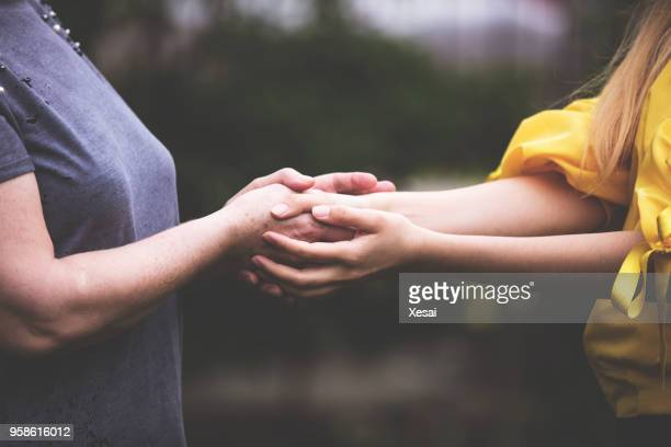 old and young hands - all gave some some gave all stock pictures, royalty-free photos & images
