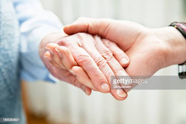 old and young hands togetherness care