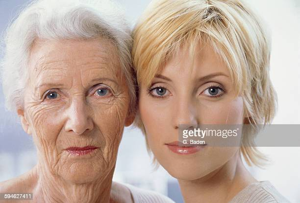 Old and young woman side by side