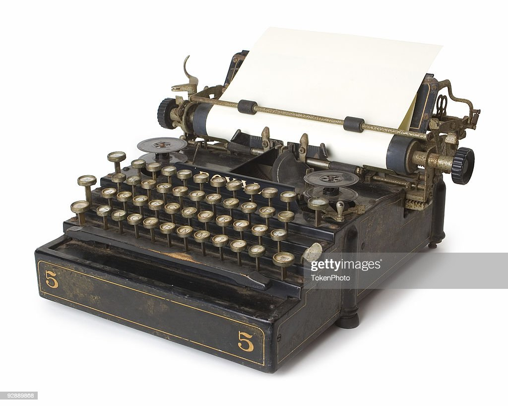 A old antique typewriter with blank paper : Stock Photo