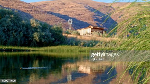 old antique windmill and shed john day river cottonwood canyon oregon 40 - condon stock pictures, royalty-free photos & images