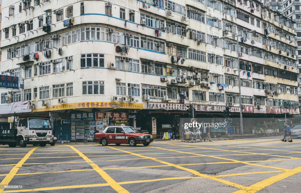small old apartment building. old apartment building and street view in Hong Kong  Stock Photo Old Apartment Building And Street View In