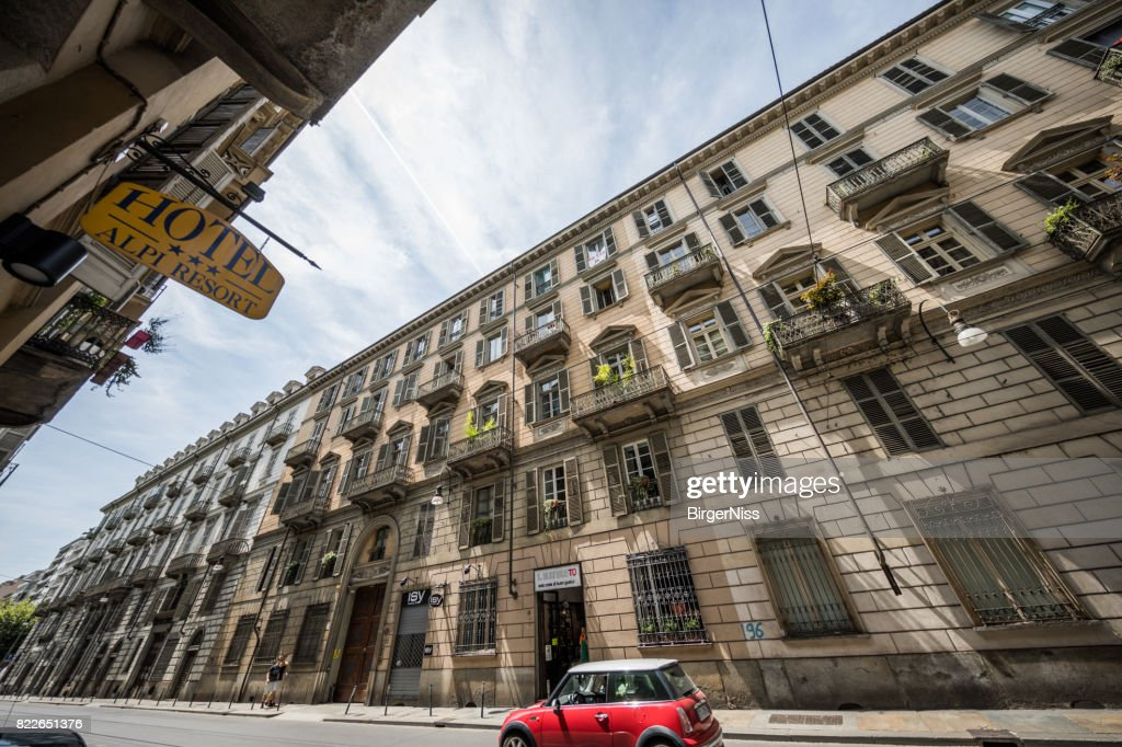 Old apartment building in central Torino, Italy : Stock Photo