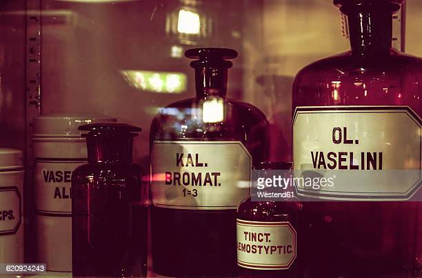 Old apothecary bottles in an apothecary cabinet