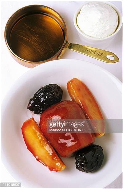 Old Armagnac baba roasted apples and prunes from Agen in Paris France on January 01st 2005
