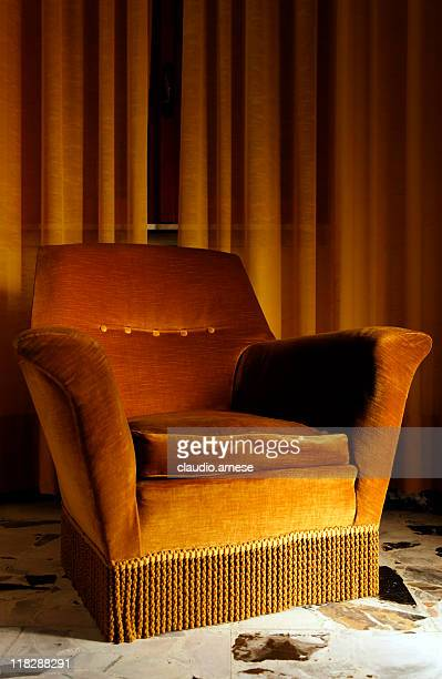 old armchair in a bed and breakfast. color image - reclining chair stock photos and pictures