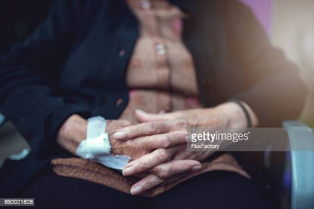old arthritis hands - infused stock pictures, royalty-free photos & images