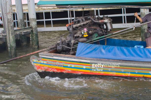 Old auto engines power long-tail boats on the Bangkok canals