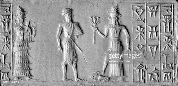 Old Babylonian cylinder seal with depiction of the man with the mace conventional name for an unidentified possibly divine figure Behind him stands a...