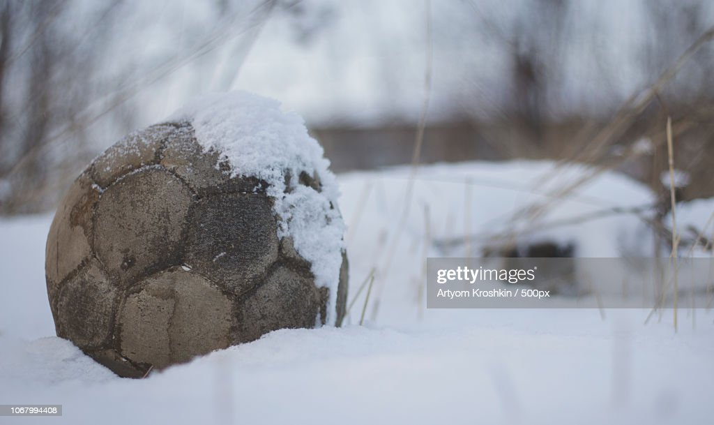 Old ball in snow : Stock Photo