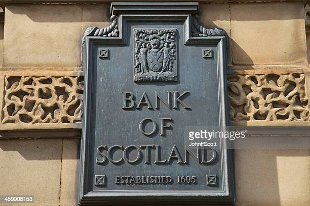 old bank of scotland sign on an exterior wall - johnfscott stock pictures, royalty-free photos & images