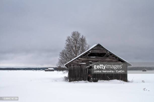 old barn house under the grey skies - heinovirta stock pictures, royalty-free photos & images