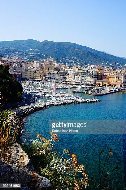 old bastia and blue sea, corsica, france - corsica stock photos and pictures