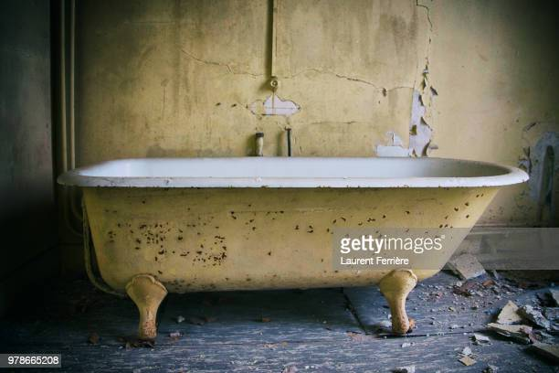 Old bathtub in abandoned room
