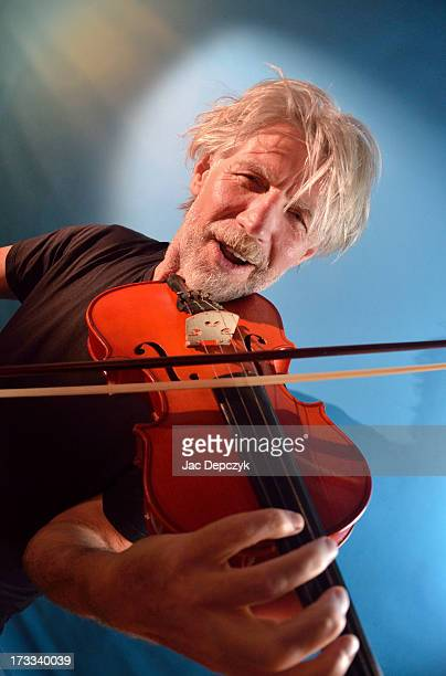 old bearded musician enjoys making violin tunes - depczyk stock pictures, royalty-free photos & images