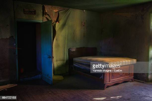 Old Bed In Abandoned Room