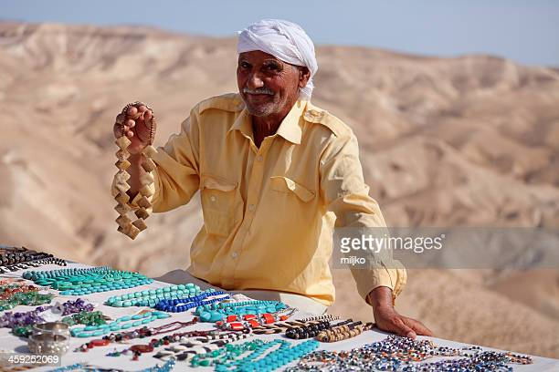 Old bedouin offering a necklace