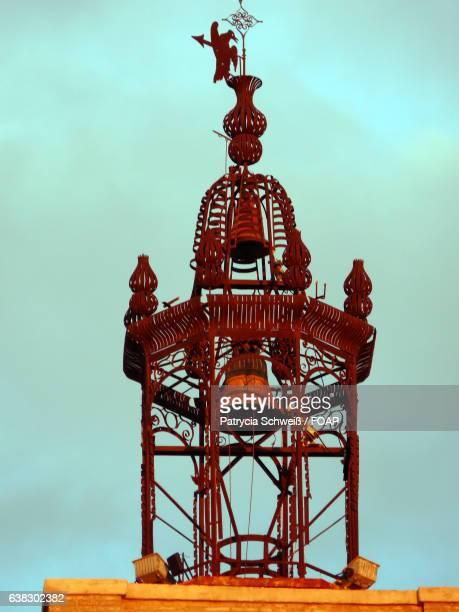Old bell against sky