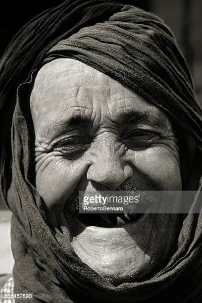 Old Berber laughing looking at the camera Black White