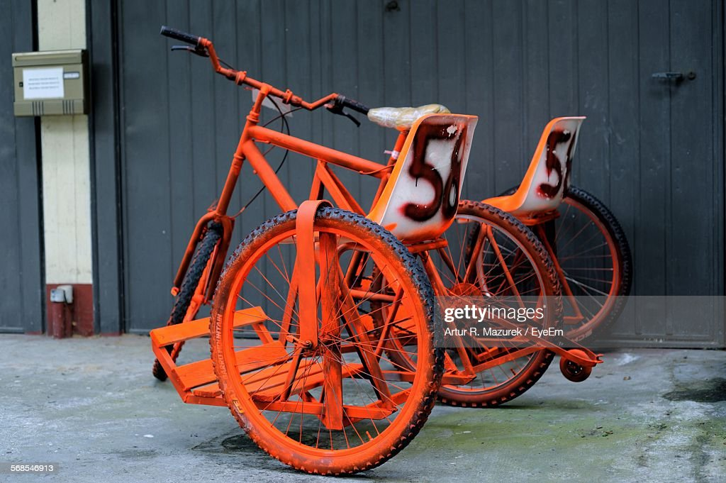 Old Bicycle On Street By Wall : Stock Photo