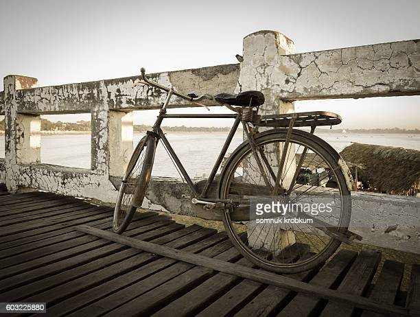 Old bicycle parked on Ubein teak wood bridge at Mandalay,Myanmar.