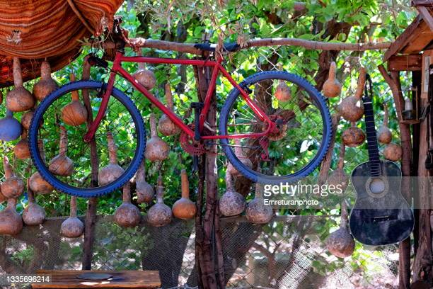 old bike and guitar used as decoration outdoors. - emreturanphoto stock pictures, royalty-free photos & images