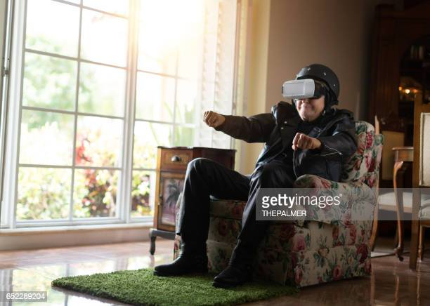 Old biker using virtual reality