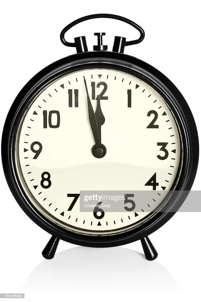 Old Black Alarm Clock Showing 1158am Pm Stock Photo