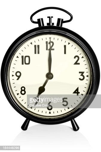 old black alarm clock showing 7am 7pm stock photo getty