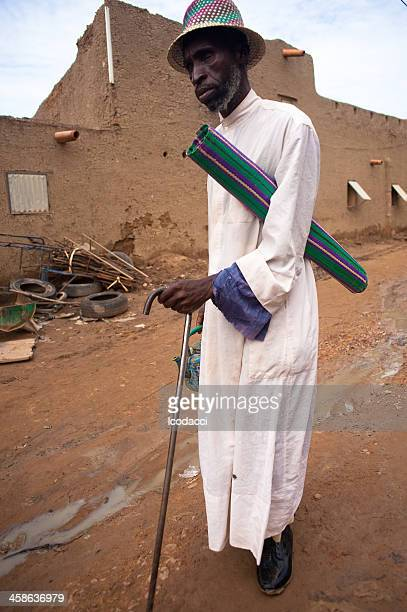 old black man walking on his city - school cane stock photos and pictures