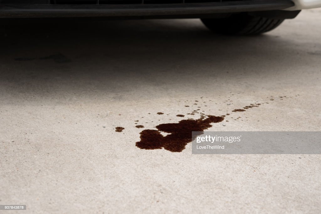 Old black oil used of car auto mobile leak and drop on concrete floor , check and maintenance service : Stock Photo