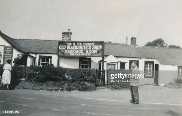 Old Blacksmith's Shop and Marriage Room, Gretna Green, Scotland, 1940s? Sign reading: 'This is the famous Old Blacksmith's Shop and Marriage Room,...