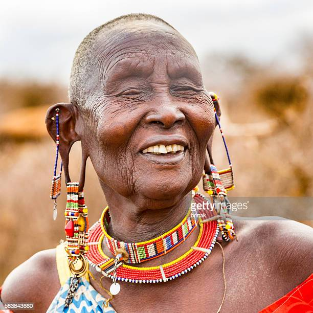 Old blind Maasai woman with a happy smile. Kenya.