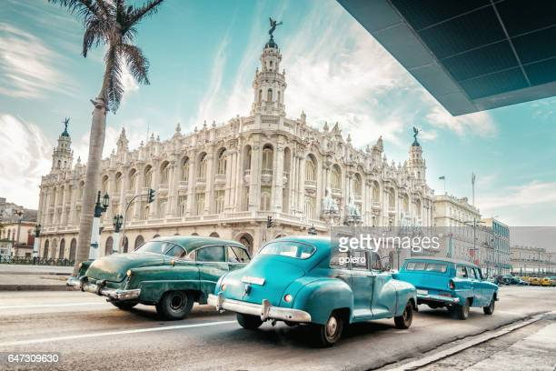 old blue american car in front of gran teatro of havanna - havana stock pictures, royalty-free photos & images