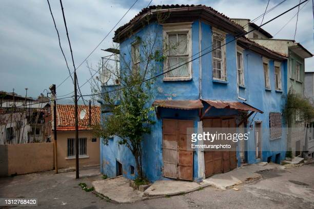 old blue house with closed grocery shop in izmir. - emreturanphoto stock pictures, royalty-free photos & images