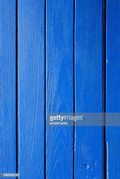 Old blue painted wooden boarding.