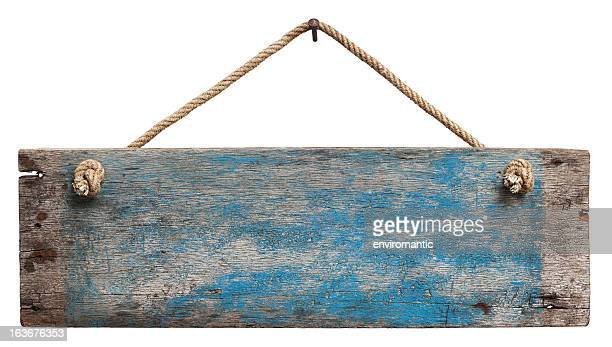 Old blue weathered wood signboard.