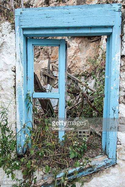 Old blue window of a house in ruins. In Athens, Greece.