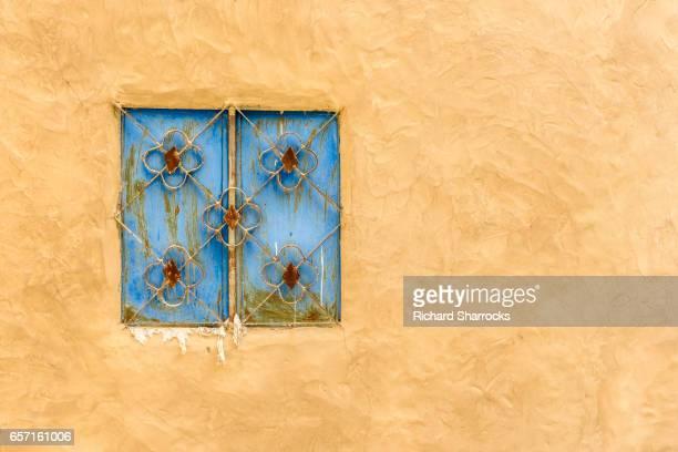 Old blue window shutter