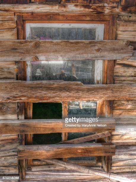 Old Boarded Up Cabin Window