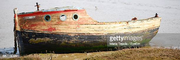 old boat moored at sea shore - maria tejada stock pictures, royalty-free photos & images